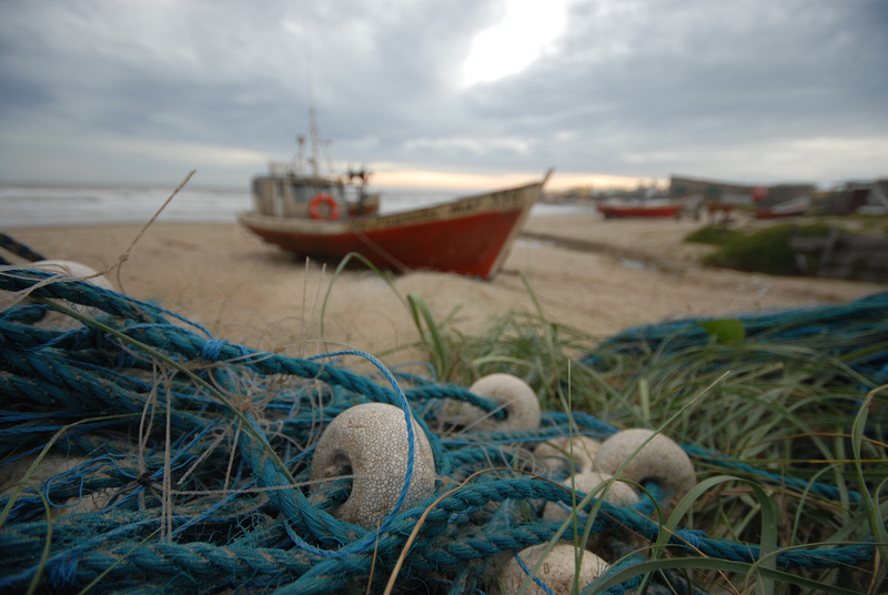 Fishing nets and fishing boat in the background